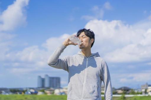 Sports men drinking water