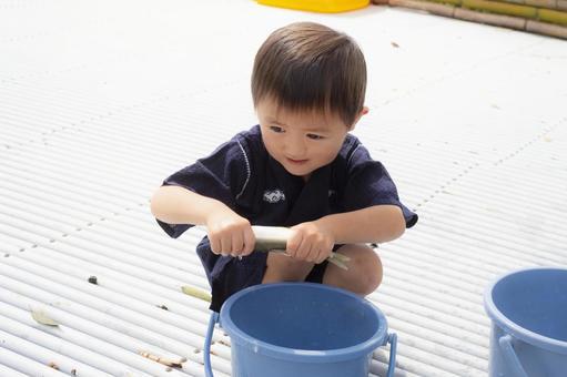 4-year-old child catching sweetfish