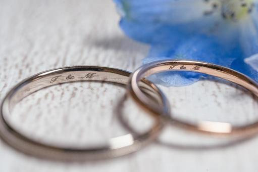 Marriage registration, engagement ring, wedding ring and delphinium