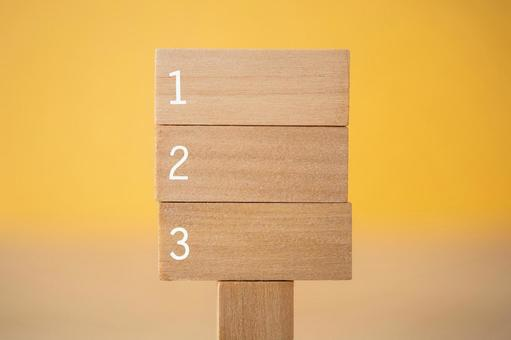 Wooden information board labeled 123