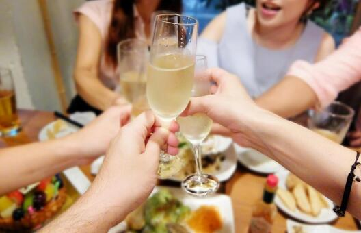 Toast with champagne at a party with women and food