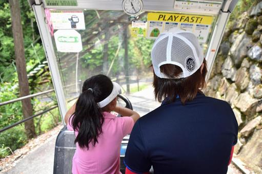 Parent and child golfer