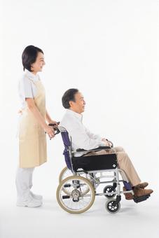 A nurse and a wheelchair male 11
