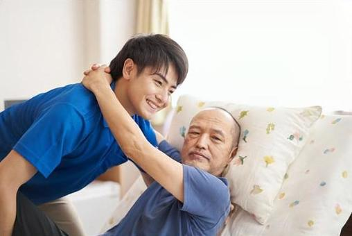 Male caregiver with an elderly person