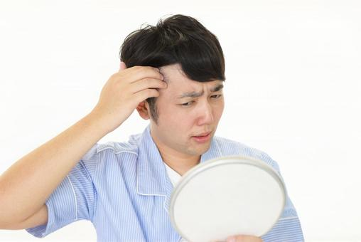 A man suffering from gray hair on the hairline