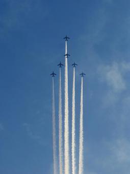Blue impulse flying blue sky