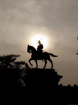 Equestrian statue of Masamune Date with the sun behind
