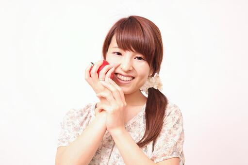 A woman with an apple 1