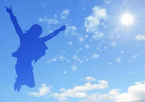 Woman silhouette jumping in the sky