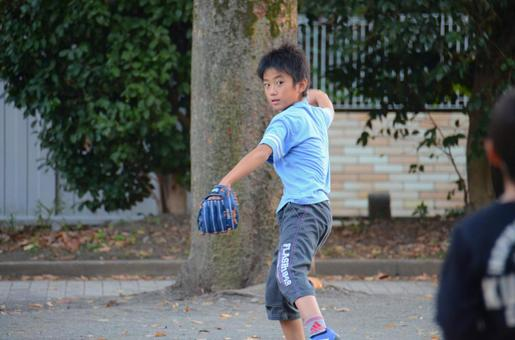A boy playing a catch ball