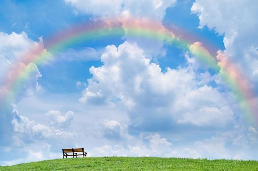 Rainbow sky and bench