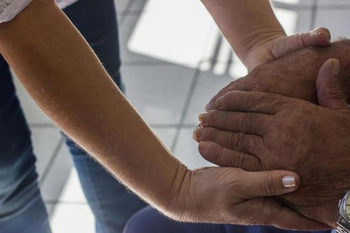 Elderly hands and supporting hands 12