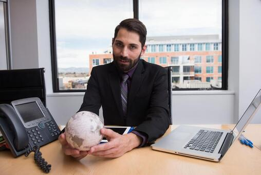 Company employee touching the globe 13