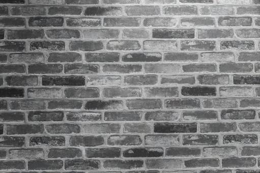 Monochrome mixed brick wall background material