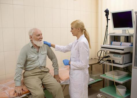 Foreign nurse female doctor examining with foreign nursing male receiving gastroscope camera examination 10