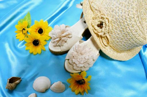 Straw hat and sandals summer image