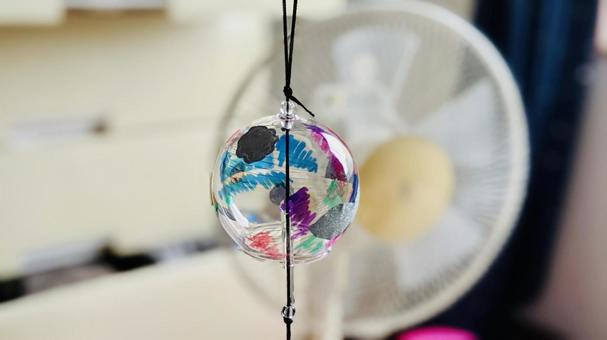 Image of summer Fan and wind chime