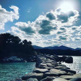 Blue sky, sun and winter sea
