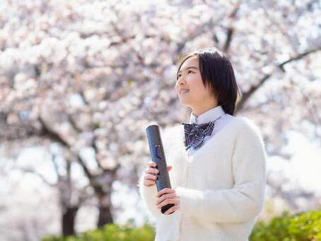 Image of graduating cherry blossom high school girls