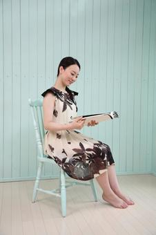 Woman sitting in a chair and reading a book 5