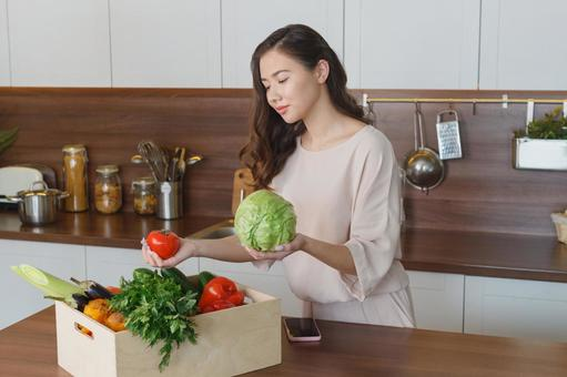 Woman with vegetables in the kitchen