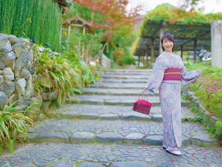 A smiling woman in a kimono