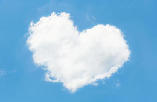 Heart-shaped clouds and blue sky