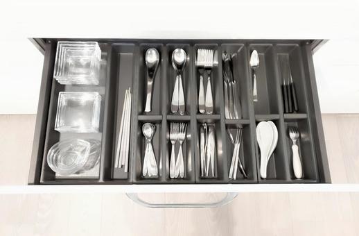 Cupboard cutlery storage