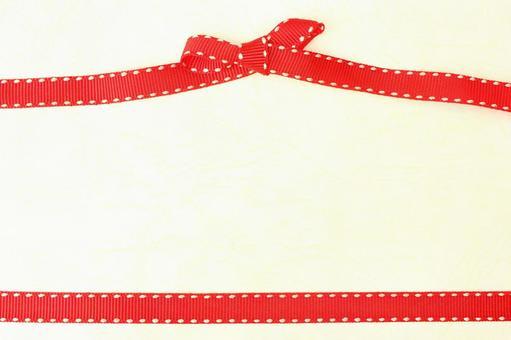 红丝带纹理背景奶油色的丝带绑色带
