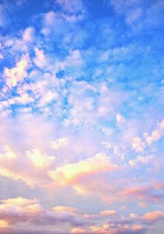 Beautiful and fantastic clouds in the sunset blue sky texture background glitter shine blue wallpaper image beautiful superb view