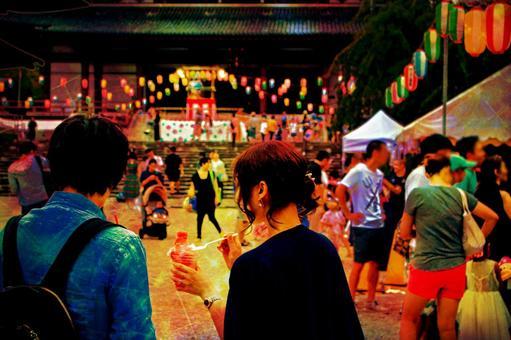 A couple enjoying the summer festival