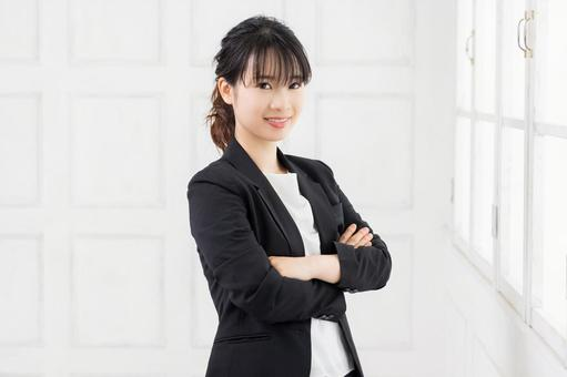 Young woman with arms folded