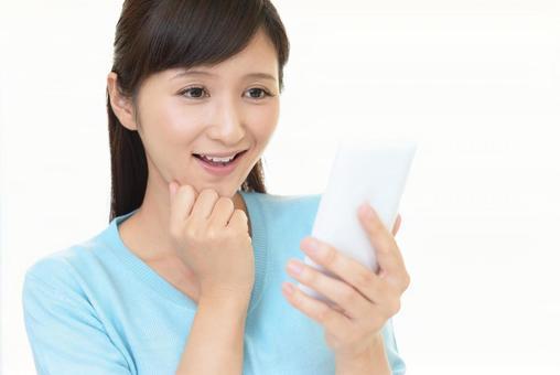 Female smartphone rejoices