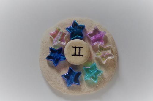 Stars surround the Gemini mark (spiritual)