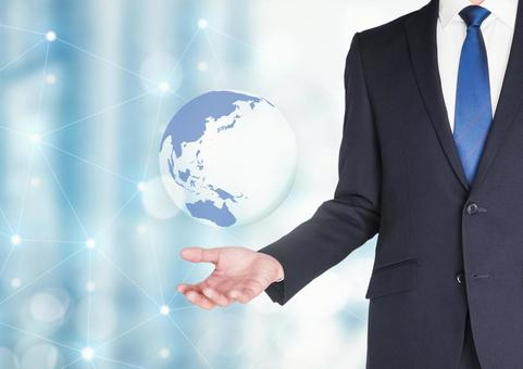 Image of businessman and the earth