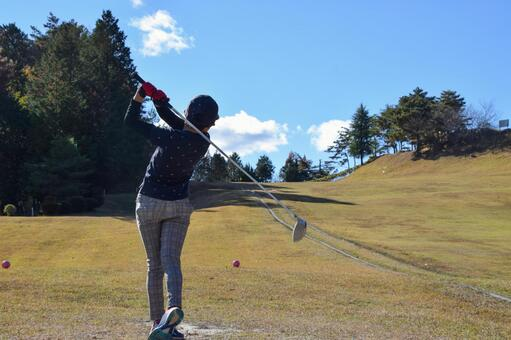 Follow-through of golf tee shot