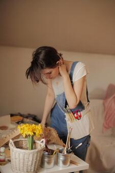 A woman making an object 18