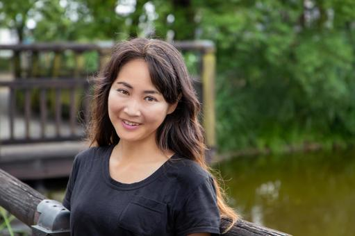 A smiling woman against the backdrop of a moat