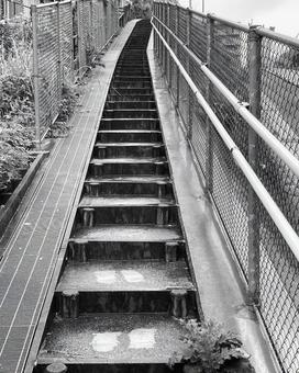 Narrow stairs on the side road Uphill monochrome (2)