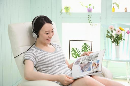 A woman reading a book while listening to music 2