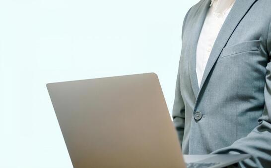 Business man facing a personal computer
