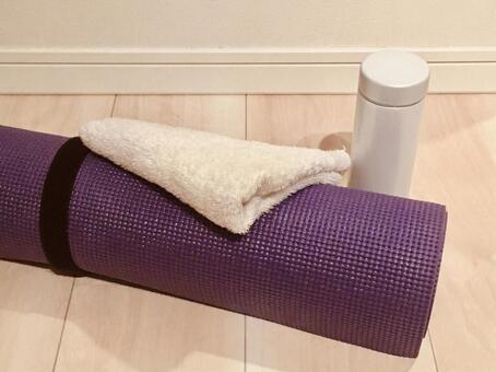 Yoga mat, water bottle, towel