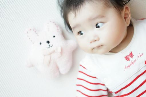 Baby looking at a stuffed toy
