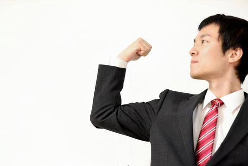 Young businessman doing a guts pose