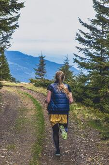 A woman running on a mountain path 4