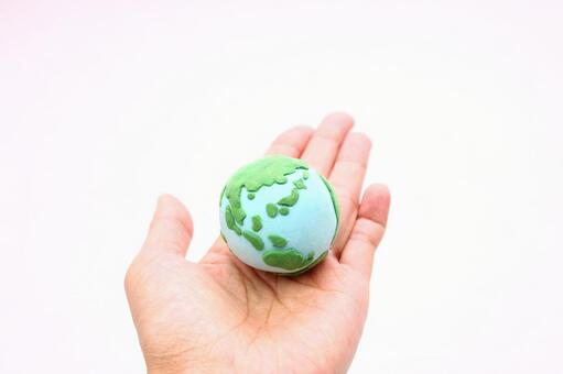 Clay art hand holding the earth 9