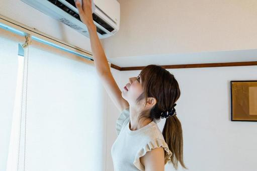 Woman wiping the air conditioner