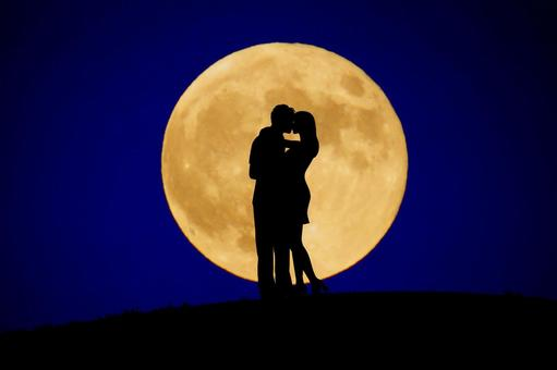 Two people kissing the moon back