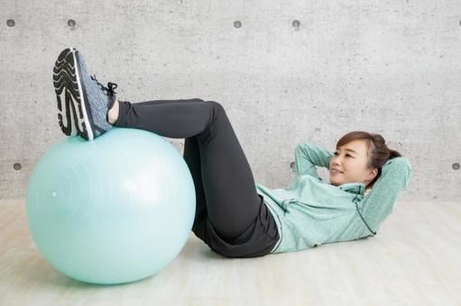 Woman using balance ball
