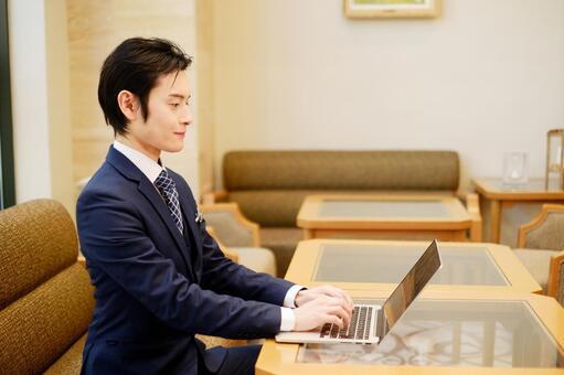 Hotel Man 2 using a laptop